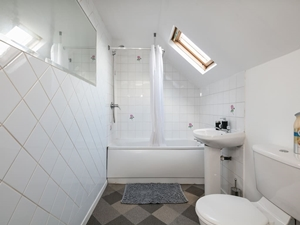 Second bathroom with bath and shower